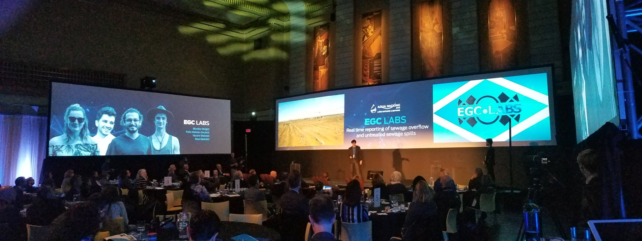 The scene at Aquahacking with Felix presenting and Yacine doing nothing