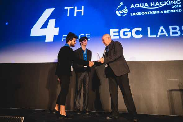 Yacine and Felix receiving the fourth prize at Aquahacking