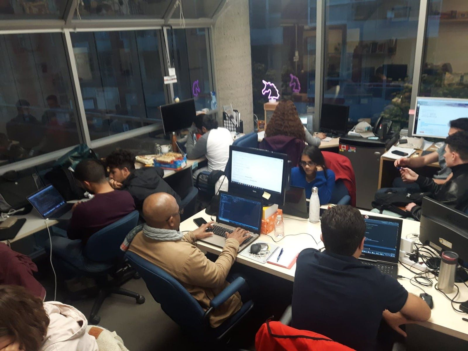 A very very crowded office with the GRAD4 team